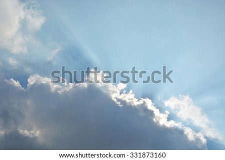 Clouds with blue sky and rays  - stock photo