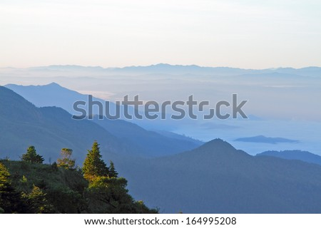 Clouds with mountain and tree
