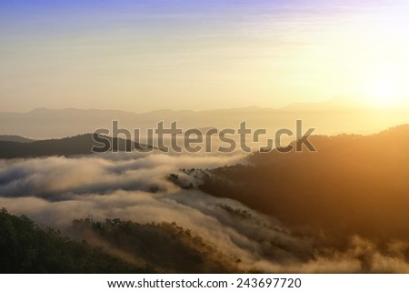 clouds with mountain and tree - stock photo