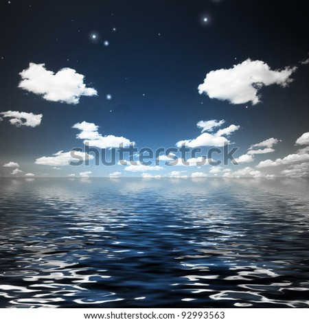 Clouds with stars over rippling water - stock photo