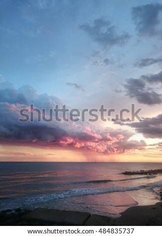 cloudscape above sunset Tyrrhenian sea, Anzio, Italy