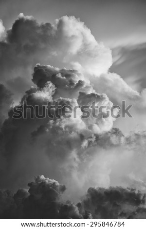cloudscape at sunset with dramatic cloud in black and white - stock photo