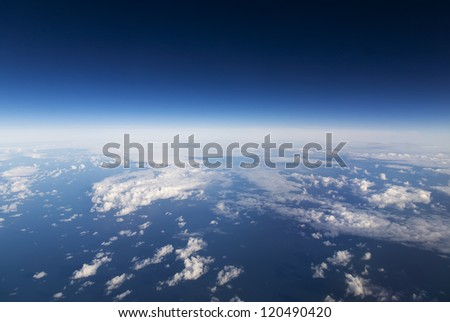 Cloudscape. Blue sky and white cloud. Sea and islandes.
