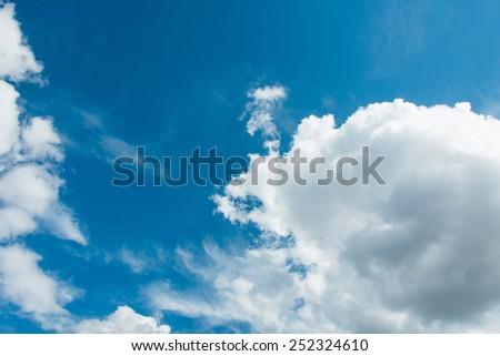 Cloudscape of bright blue sky - stock photo