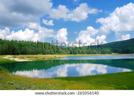 cloudscape on Black Lake in Durmitor National Park, Montenegro - stock photo