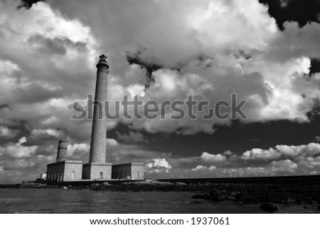 Cloudscape over a lighthouse in Normandy, France