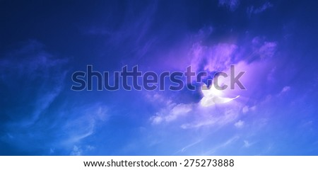 cloudscape with a white dove nearby a sunburst with motion blur lines in the clouds and the wings                         - stock photo