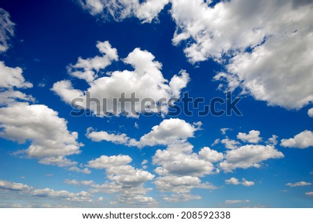Cloudscape with cumulus clouds and blue sky - stock photo