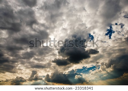 Cloudscape with sun ray shining through. - stock photo