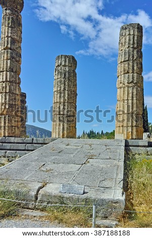 Cloudscape with The Temple of Apollo in Ancient Greek archaeological site of Delphi,Central Greece - stock photo