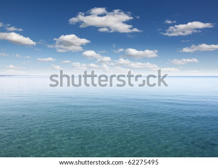 cloudy a blue surface of the sea - stock photo