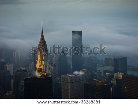 Cloudy and foggy Manhattan in New York City - stock photo