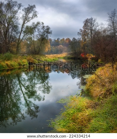 Cloudy autumn landscape on the banks of the river