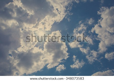Cloudy blue sky and sun
