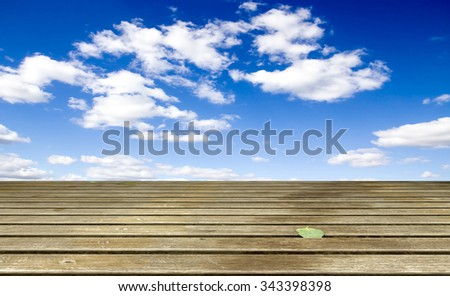 Cloudy blue sky and wood floor, background image. - stock photo