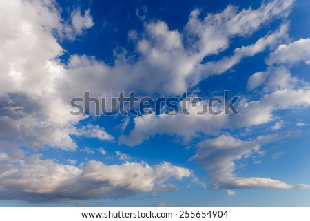 Cloudy blue sky with puffy clouds in winter in Greece - stock photo