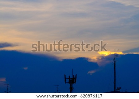Cloudy blue sky with sun ray and antenna background texture
