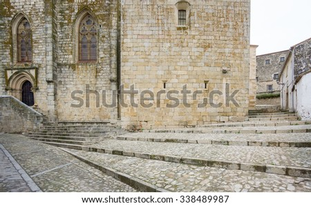 Cloudy day in Trujillo with paved street and stone stairs, Spain
