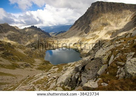 Cloudy day, small lake, Andorra - Pyrenees mountain - stock photo