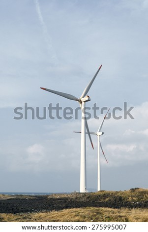 cloudy evening landscape with two windgenerator at a coast in Jeju Island, Korea.
