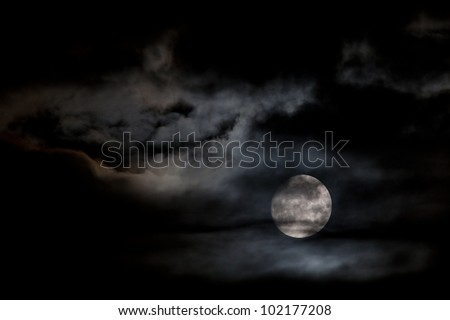 Cloudy full moon - stock photo