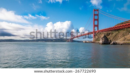 Cloudy Golden Gate Bridge with room for text - stock photo