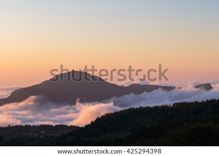 Cloudy Landscape covering the hills of Sicily. Lovely evening Sunset in the Madonie Mountains of Italy, Europe. Tranquil Serene Atmosphere - stock photo
