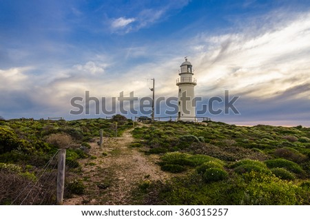 Cloudy landscape with a lighthouse