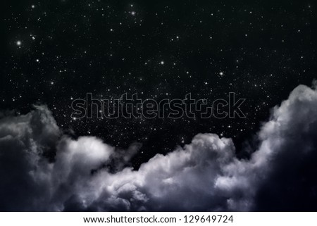 cloudy night sky with stars - stock photo
