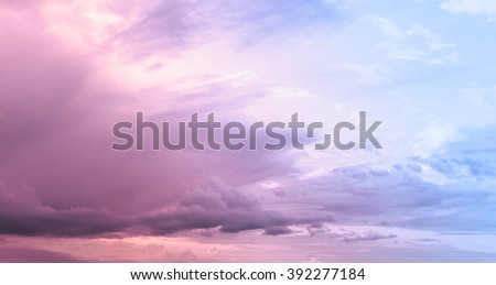 Cloudy pink sky after the storm in summer time - stock photo