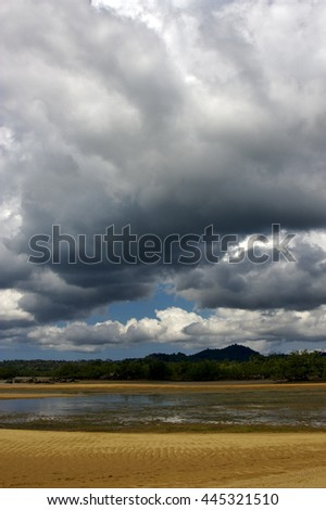 cloudy rain   river   palm  rock stone branch hill lagoon and coastline in madagascar nosy be - stock photo