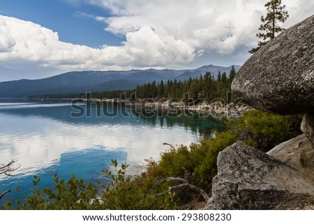 cloudy reflection landscape of Lake Tahoe in a Spring morning