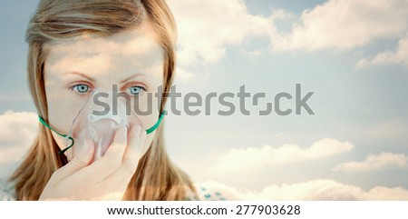 Cloudy sky against diseased young woman wearing a mask - stock photo