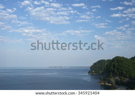 Cloudy sky and blue sea horizon abstract background