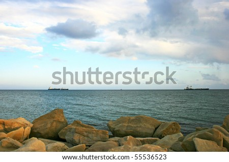 Cloudy sky and sea at sunset. - stock photo