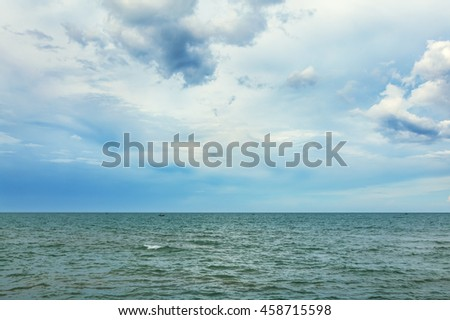 cloudy sky and surface of sea in the cloudy day - stock photo