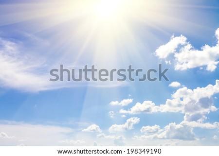 cloudy sky blue with sun - stock photo
