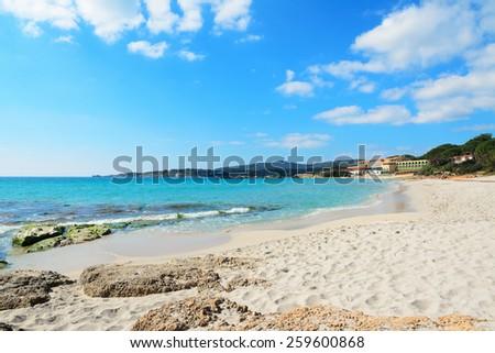 cloudy sky over Le Bombarde beach, Sardinia - stock photo