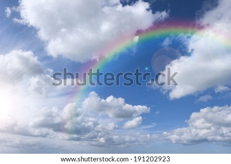 Cloudy sky with rainbow and bright sky