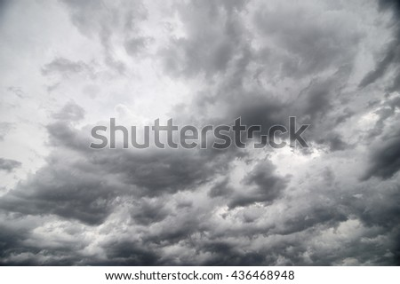 Cloudy stormy black and white dramatic sky background, Dark ominous grey storm clouds, Abstract dark background ,Dark clouds - stock photo
