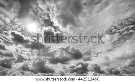 Cloudy stormy black and white dramatic sky with sun rays, Dark ominous grey storm clouds, Abstract dark tone background ,Dark clouds background - stock photo