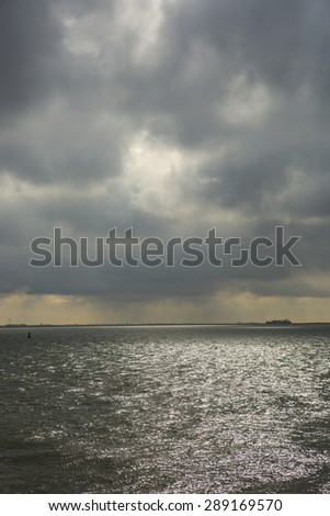 cloudy sunrise seaside view , Breskens, The Netherlands - stock photo