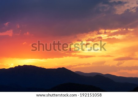 Cloudy sunset, landscape in mountains - stock photo