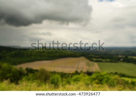 Cloudy view over the Chilterns in Buckinghamshire, England Out of focus.