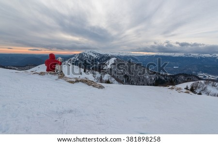 Cloudy winter sunset in the mountains. Beautiful evening scene in Julian Alps.