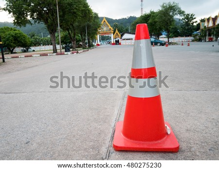 Clouse-up a traffic cone on the road with blur background..