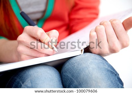 Clouse-up of female hands writing in notebook