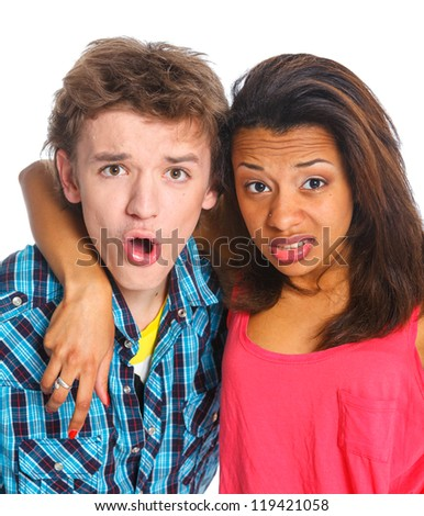 Clouse-up portrait emotional young man with pretty girlfriend. Isolated on white background.