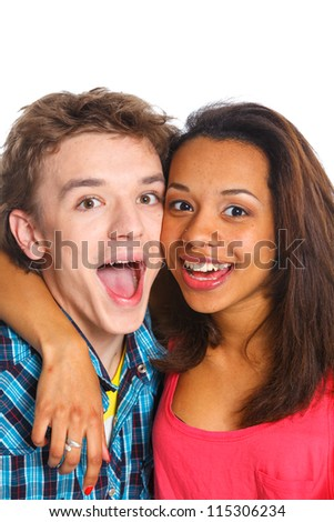 Clouse-up portrait smiling young man with pretty girlfriend. Isolated on white background.