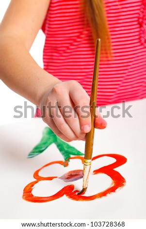 Clouse up view hand girl with paint draws flower - stock photo